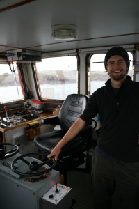Adam driving the M.V. Loch Buie