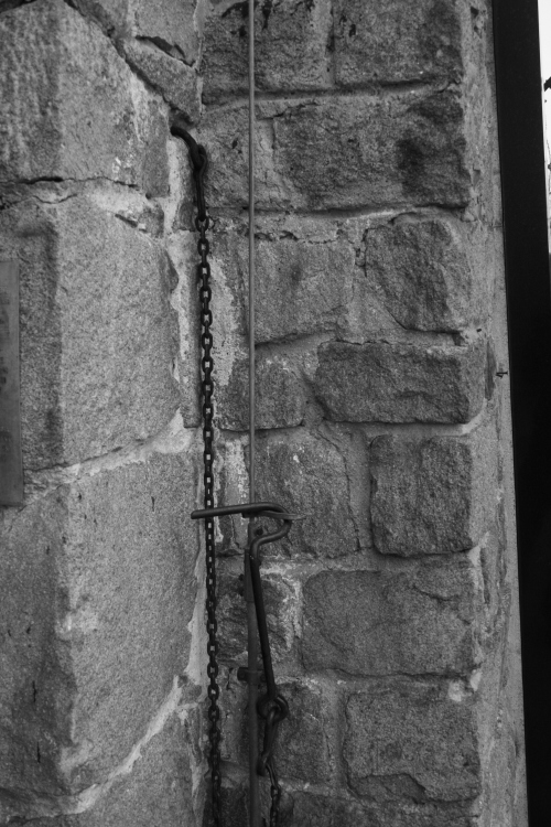 The Iron Chain was used to fasten the front gate when it was open.  It was used to hang prisoners and suffocate them to death.